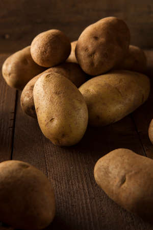 sackcloth: Organic Raw Brown Potatoes in a Basket Stock Photo