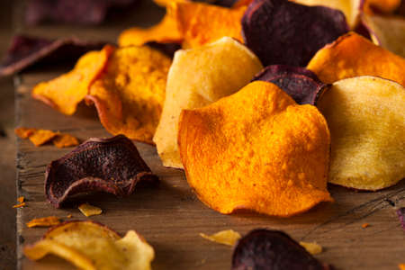 potato chip: Healthy Homemade Vegetable Chips on a Cutting Board