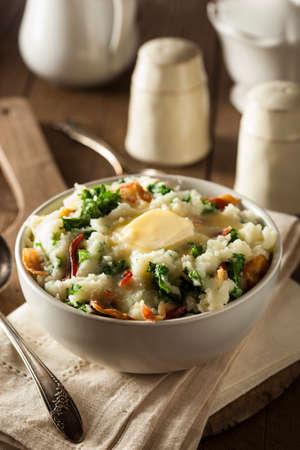 uk cuisine: Homemade Irish Potato Colcannon with Greens and Pork Stock Photo