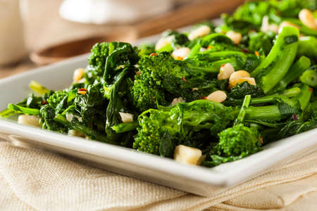 Homemade Sauteed Green Broccoli Rabe with Garlic and Nuts Stock Photo - 36930759