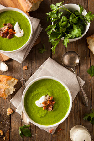 Homemade Green Spring Pea Soup with Cream and Bacon