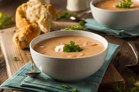 lobster: Homemade Lobster Bisque Soup with Cream and Parsley