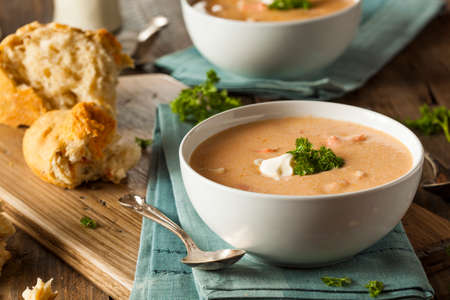 lobster tail: Homemade Lobster Bisque Soup with Cream and Parsley