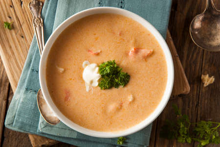 Homemade Lobster Bisque Soup with Cream and Parsley