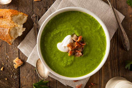hot soup: Homemade Green Spring Pea Soup with Cream and Bacon