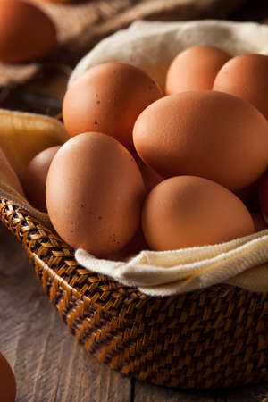 hard boiled: Raw Organic Brown Eggs in a Basket Stock Photo