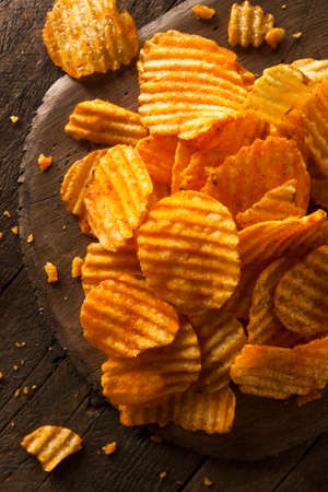 fried food: Hot Barbeque Potato Chips Ready to Eat Stock Photo
