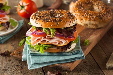 deli sandwich: Healthy Turkey Sandwich on a Bagel with Lettuce and Tomato