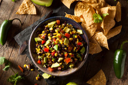 chips and salsa: Homemade Texas Caviar Been Dip with Chips Stock Photo