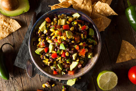 tomato: Homemade Texas Caviar Been Dip with Chips Stock Photo