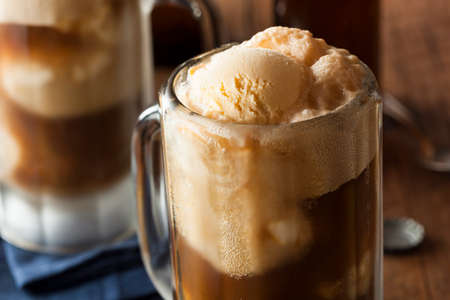 glasses of beer: Refreshing Root Beer Float with Vanilla Ice Cream
