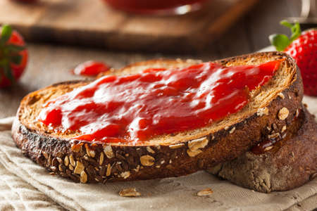 wheat toast: Homemade Strawberry Jelly on Whole Wheat Toast Stock Photo