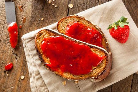 strawberry jelly: Homemade Strawberry Jelly on Whole Wheat Toast Stock Photo