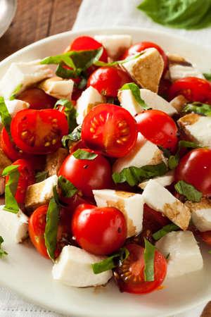 caprese salad: Homemade Healthy Caprese Salad with Tomato Mozzarella and Basil Stock Photo
