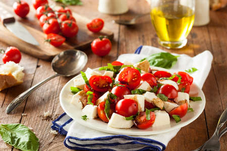 Homemade Healthy Caprese Salad with Tomato Mozzarella and Basil Stock Photo