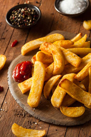 frites: Homemade Salty Steak French Fries with Ketchup Stock Photo