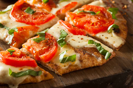 Homemade Margarita Flatbread Pizza with Tomato and Basil Stok Fotoğraf - 38374552