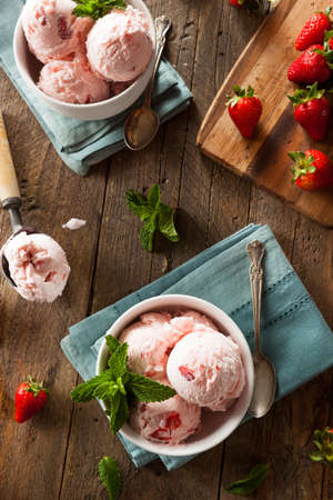 Cold Strawberry Ice Cream in a Bowl with Mint Stock Photo
