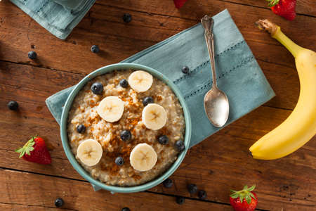 steel: Homemade Healthy Steel Cut Oatmeal with Fruit and Cinnamon Stock Photo