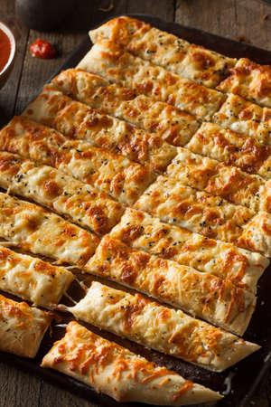 cheesy: Homemade Cheesy Breadsticks with Marinara Sauce for Dipping