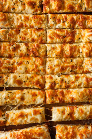 breadstick: Homemade Cheesy Breadsticks with Marinara Sauce for Dipping