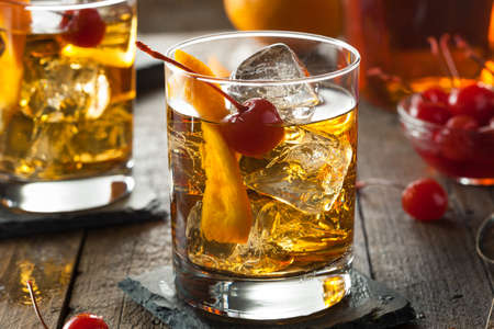 whiskey: Homemade Old Fashioned Cocktail with Cherries and Orange Peel