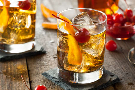 alcoholic drink: Homemade Old Fashioned Cocktail with Cherries and Orange Peel