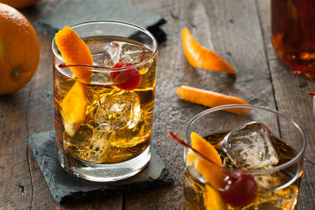 Homemade Old Fashioned Cocktail with Cherries and Orange Peel Stok Fotoğraf - 39451619