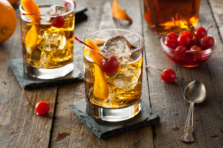 alcoholic drinks: Homemade Old Fashioned Cocktail with Cherries and Orange Peel