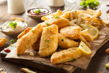 fish: Crispy Fish and Chips with Tartar Sauce Stock Photo