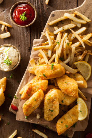 fatty food: Crispy Fish and Chips with Tartar Sauce Stock Photo