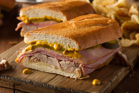 cuban: Homemade Traditional Cuban Sandwiches with Ham Pork and Cheese Stock Photo