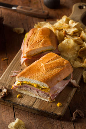 sub sandwich: Homemade Traditional Cuban Sandwiches with Ham Pork and Cheese Stock Photo