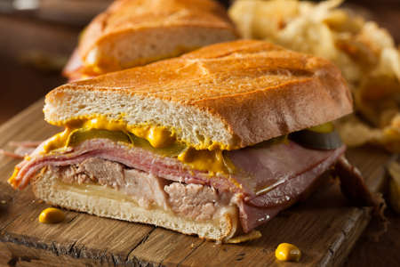 Homemade Traditional Cuban Sandwiches with Ham Pork and Cheese Standard-Bild