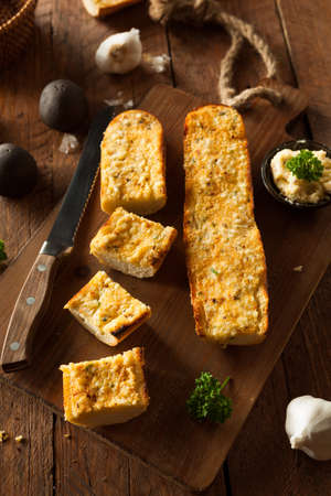 garlic bread: Homemade Cheesy Garlic Bread with Herbs and Spices