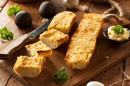 slices of bread: Homemade Cheesy Garlic Bread with Herbs and Spices