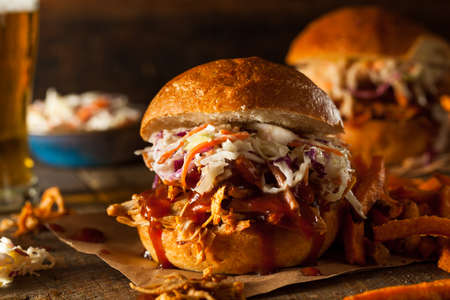 chicken sandwich: Homemade Pulled Chicken Sandwich with Coleslaw and Fries