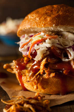 sloppy: Homemade Pulled Chicken Sandwich with Coleslaw and Fries