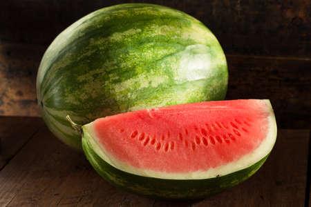 seedless: Organic Ripe Seedless Watermelon Cut into Wedges Stock Photo