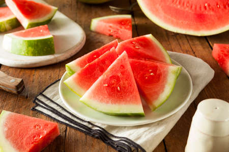 seedless: Organic Ripe Seedless Watermelon Cut into Wedges Stock Photo