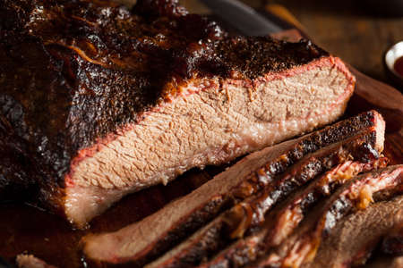 beef steak: Homemade Smoked Barbecue Beef Brisket with Sauce Stock Photo