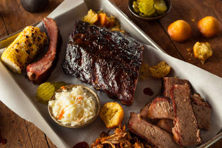 charcoal grill: Barbecue Smoked Brisket and Ribs Platter with Pulled Pork and Sides