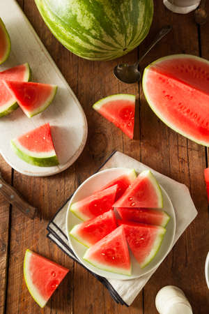 sliced watermelon: Organic Ripe Seedless Watermelon Cut into Wedges Stock Photo