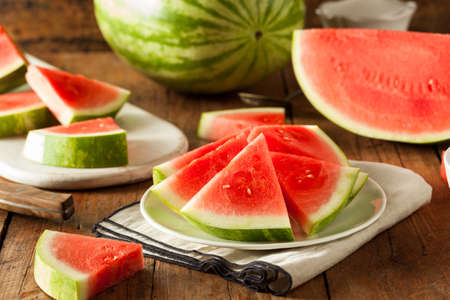 Organic Ripe Seedless Watermelon Cut into Wedges Imagens