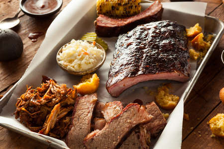 party food: Barbecue Smoked Brisket and Ribs Platter with Pulled Pork and Sides