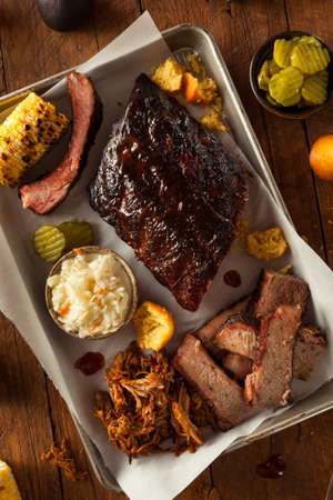 rib: Barbecue Smoked Brisket and Ribs Platter with Pulled Pork and Sides