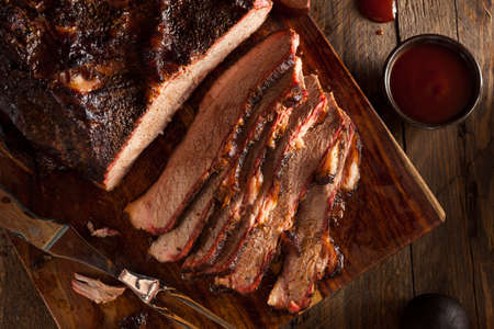 smoked: Homemade Smoked Barbecue Beef Brisket with Sauce Stock Photo