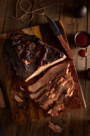 meat sauce: Homemade Smoked Barbecue Beef Brisket with Sauce Stock Photo