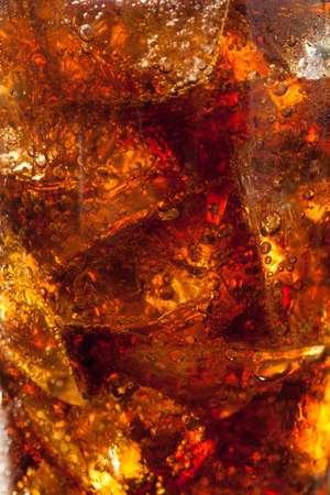 carbonation: Refreshing Bubbly Soda Pop with Ice Cubes Stock Photo