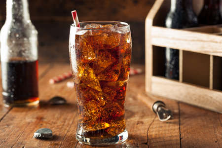 drinking soda: Refreshing Bubbly Soda Pop with Ice Cubes Stock Photo